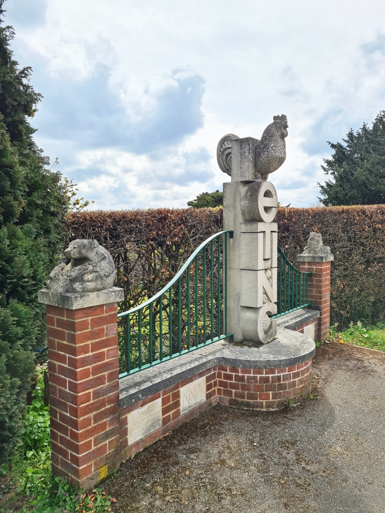 The North Downs Way passes close to the brick and stone village sign at Detling, Kent. Erected for the millennium in 2000