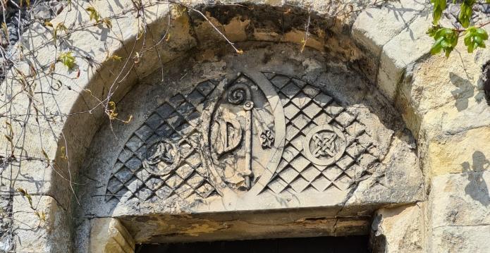 Arch above ancient door entrance to the gardens of Davington Priory