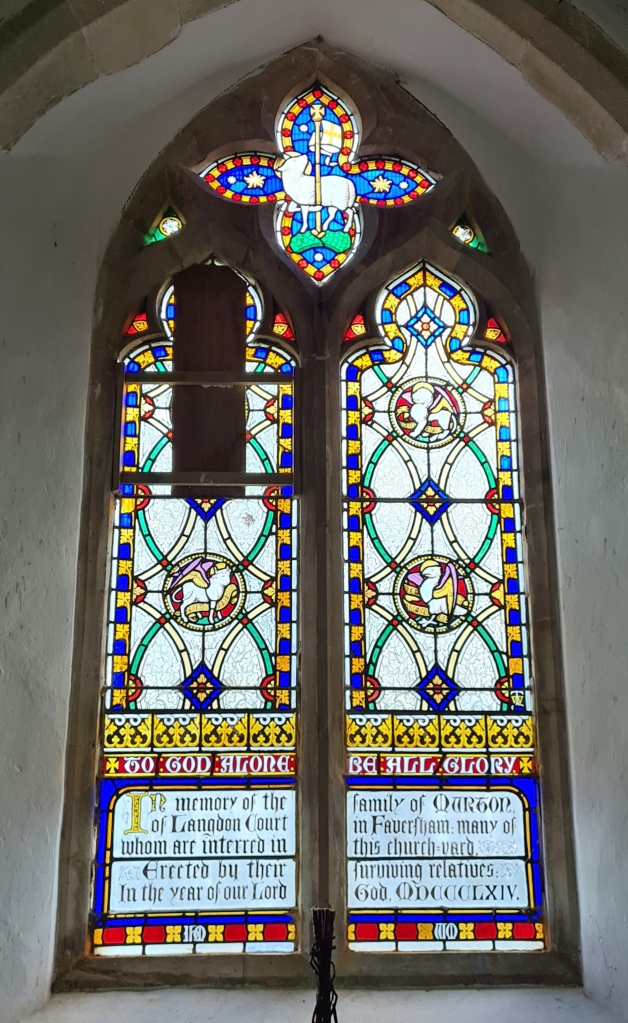 East window contains stained glass of 1864 by Thomas Willement, a memorial to the Murton family