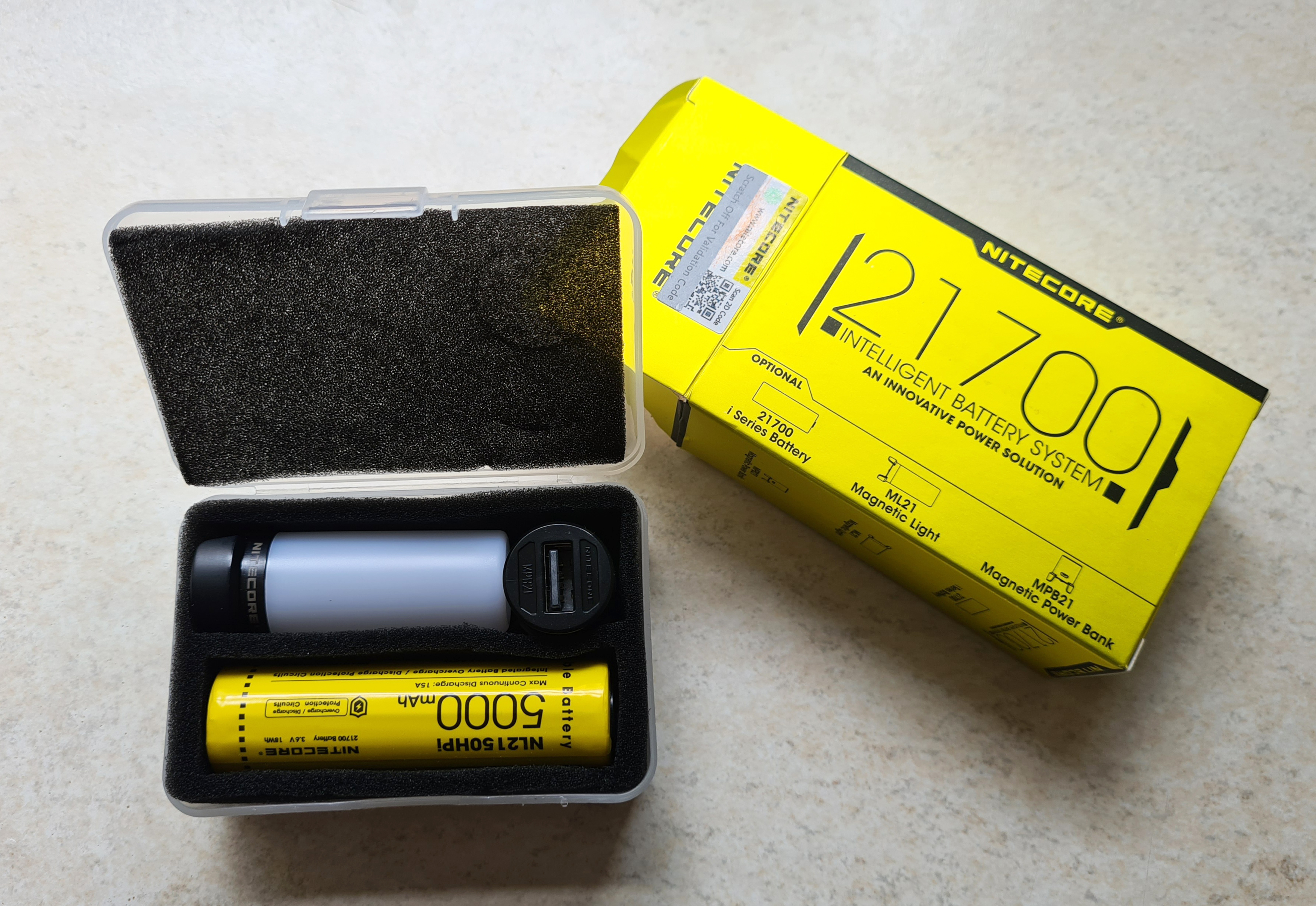The three components of the Nitecore Intelligent Battery System- 21700 i series battery, ML21 magnetic light and MPN21 magnetic power bank