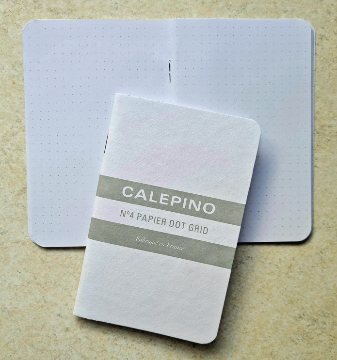 """Calepino No. 4 Dot Grid. Product Details 48 pages, Dot Grid 3.5"""" x 5.5"""" / 9 cm x 14 cm Sold in packs of 3 The Dot Grid is printed with a light grey print on French 90G paper Staple binding Made in France"""
