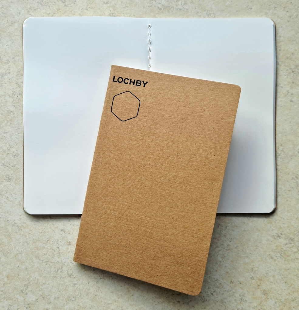 """Lochby- 72 pages of 68gsm white Tomoe River paper, stitched binding, lies flat.  3.5"""" x 5.5"""""""