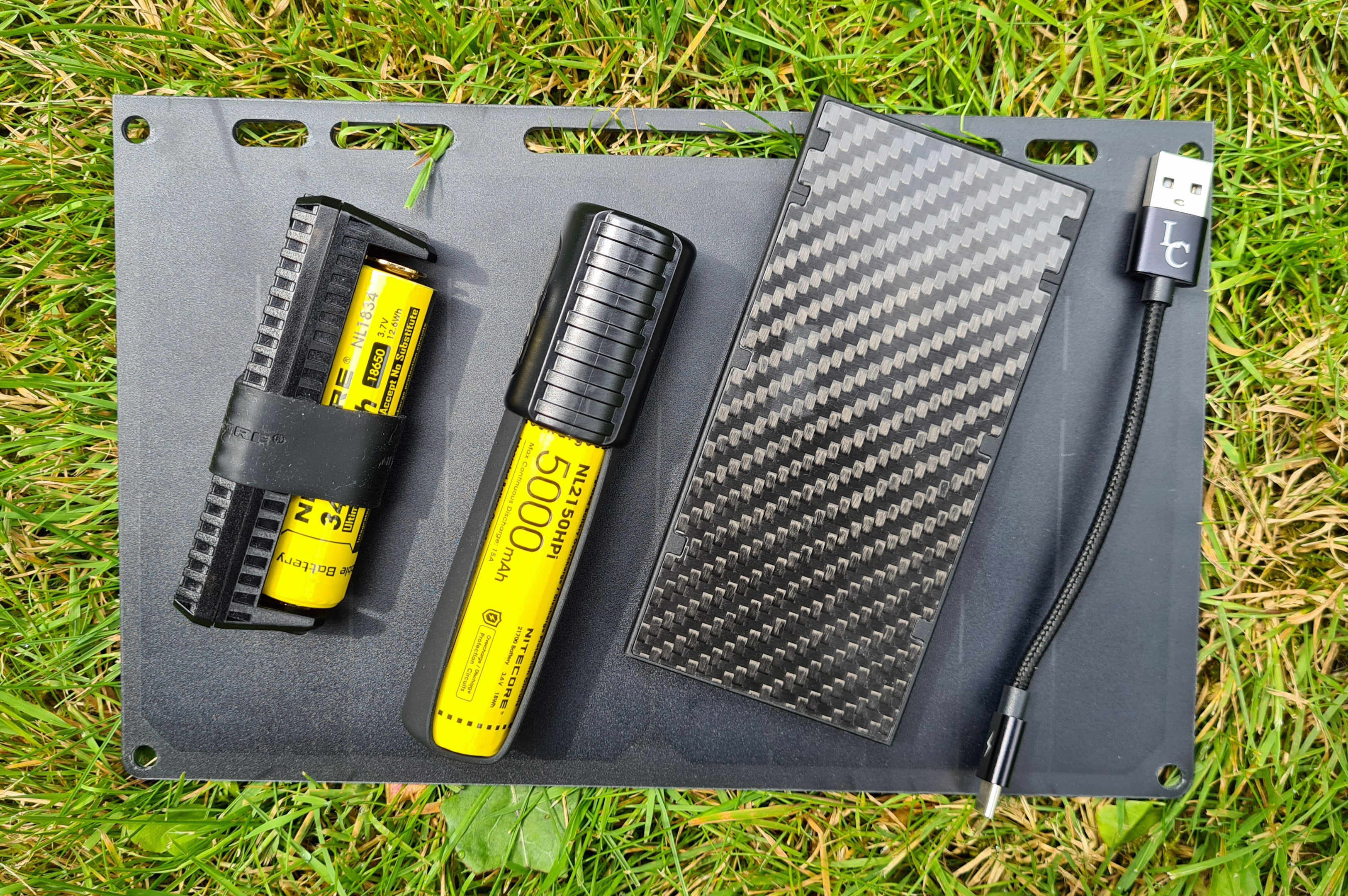 Three possible options for a solar panel / power bank set up. Lixada solar panel with either Nitecore F1 charger with 3400mAh 24650 battery, or Nitecore F21i charger with 5000mAh 21700 battery, or Nitecore 10000mAh powerbank, plus shortie lead