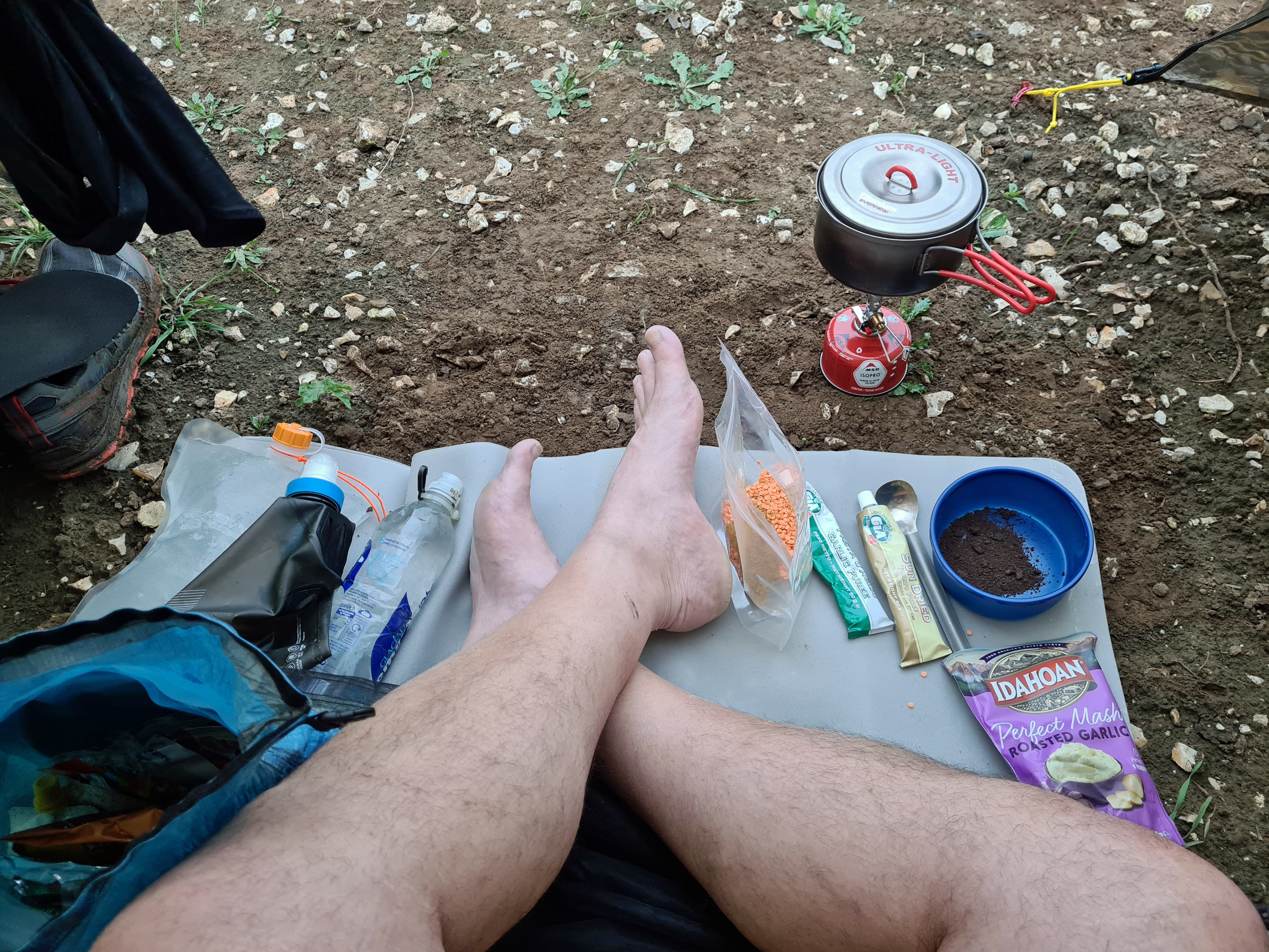 Preparing a hot Oxo and lentil curry at the end of a day's hiking