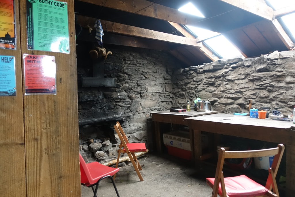 Sourlies bothy on the Cape Wrath Trail. A lone, partly used, Campingaz canister sits, unwanted on the table