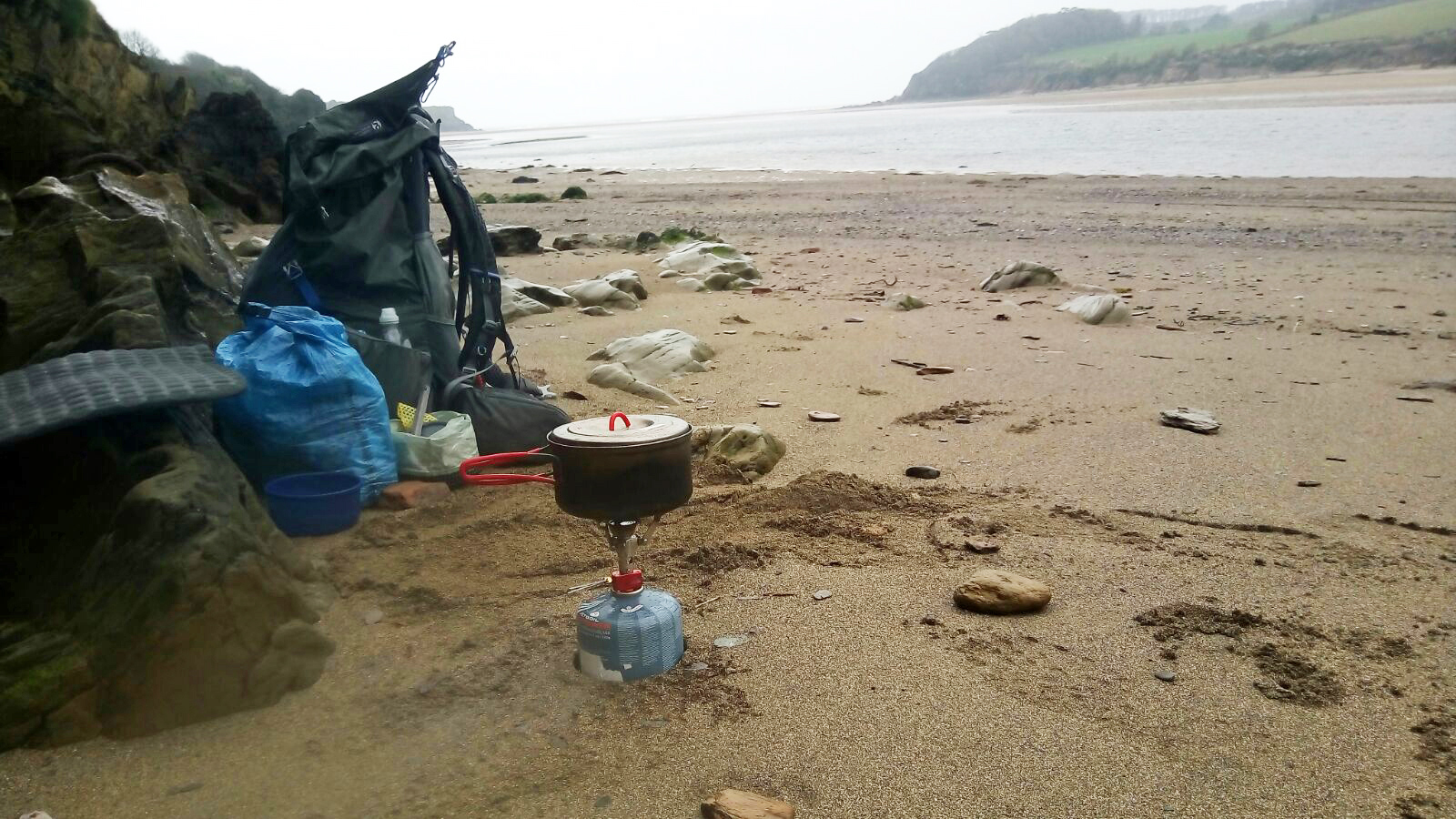 Brewing up on MSR Pocket Rocket 2 while waiting for the tide to drop before crossing the estuary. South West Coast Path