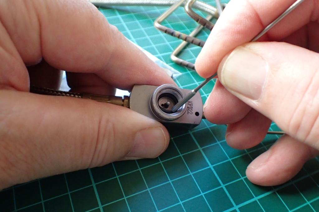 Gently easing replacement O-ring in to its seat with blunt end of pick