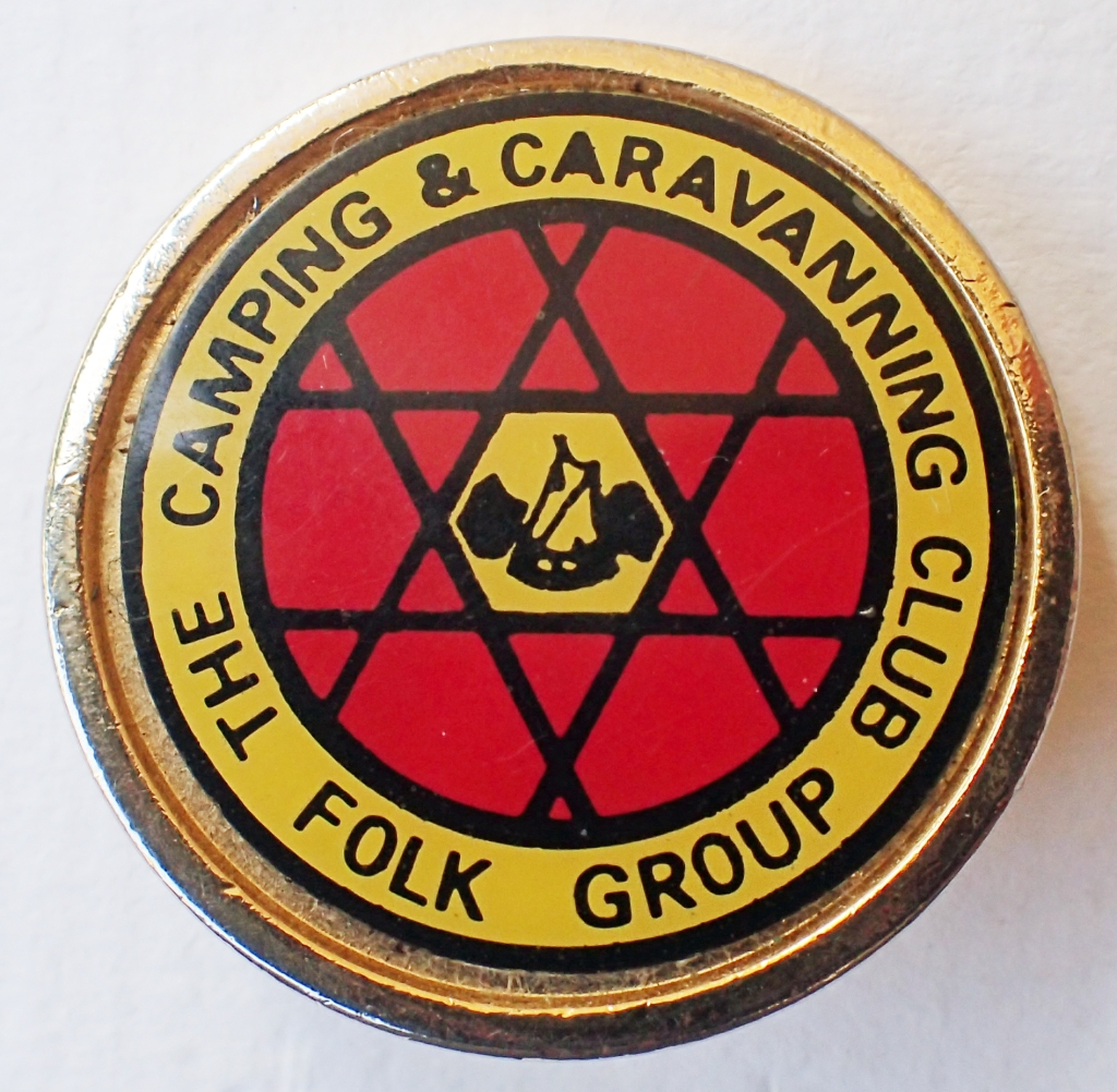 """The Camping & Caravanning Club Folk Group. Acrylic on brass. Plain gilt surround. Pin back. 29mm. No maker's name. """" British Made"""" on back"""